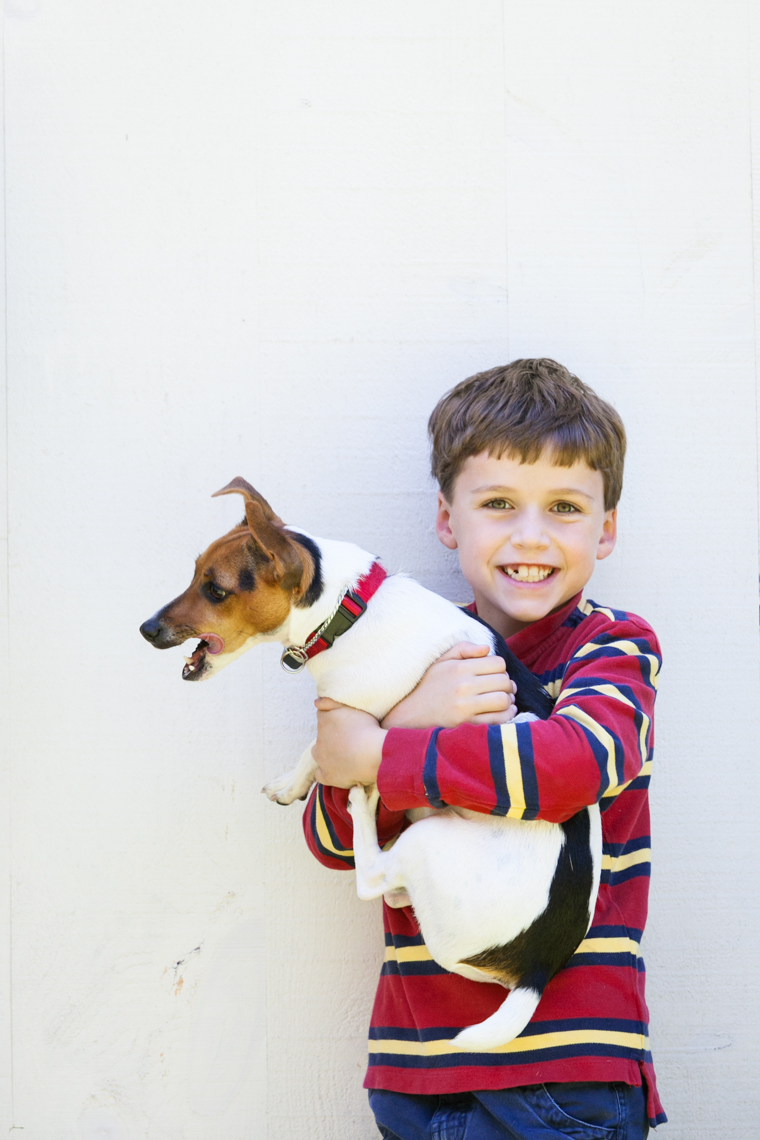 A toothy smile of a boy and his jack russell terrier dog